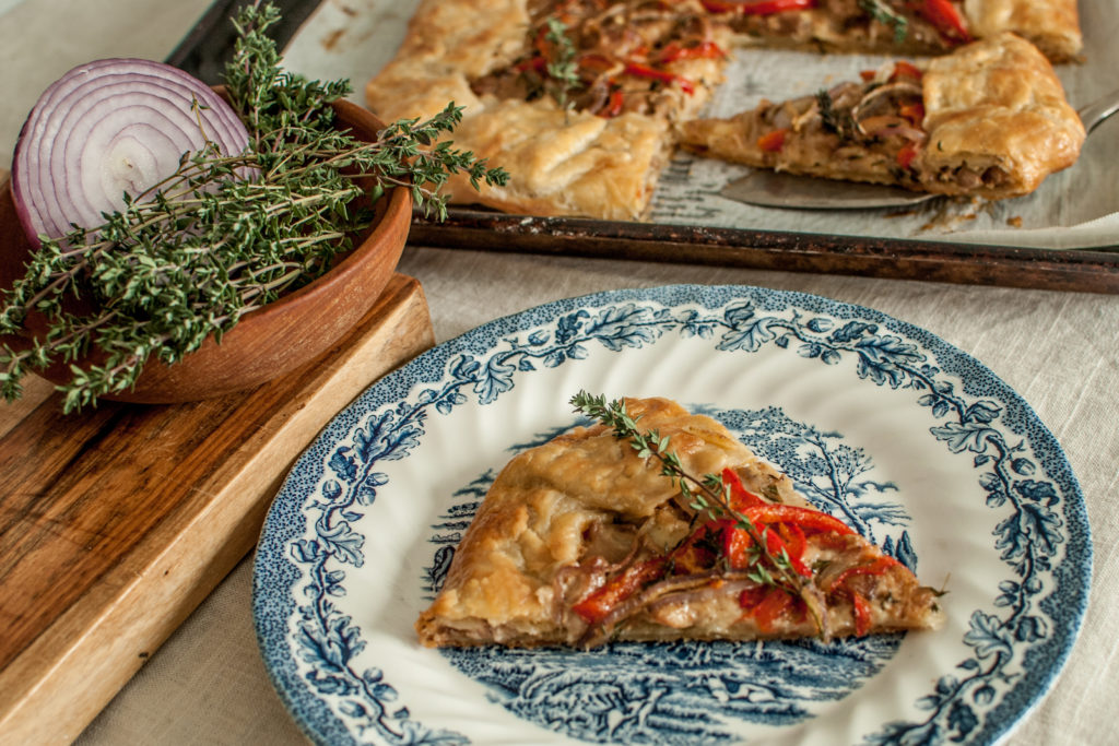 A Recipe for a Rustic Galette with a Creamy savory chicken filling! It's a wonderful alternative to the classic Chicken Pot Pie.  It's surprisingly easy to make, and the fresh herbs give it such a full flavor!  The all butter crust is a wonderful farmhouse staple of my kitchen, too!