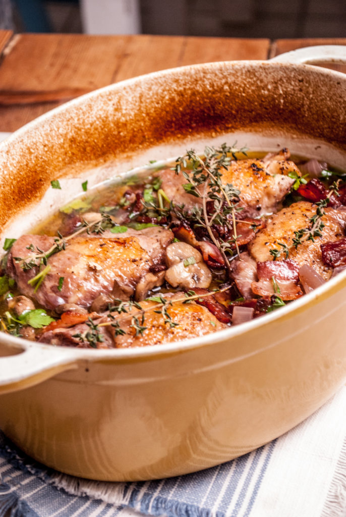 Chicken in red wine sauce, this rustic French classic dinner is full of flavor and a surprisingly easy dinner recipe to make!